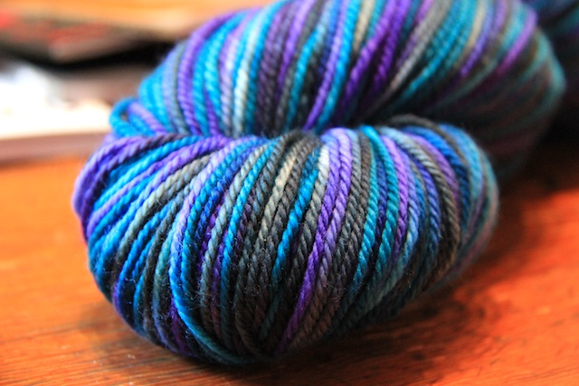 "The parents aren't telling whether it's a boy or a girl, but I think this can go either way. (In case you're curious, it's Indigodragonfly DK Superwash in ""Fringe Over Troubled Water"")"