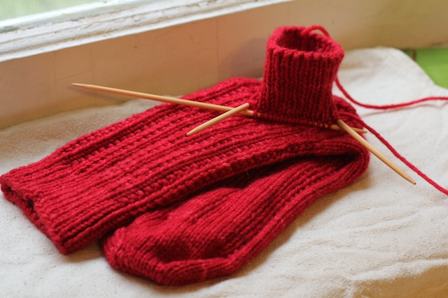 My mum asked for red socks, and now I have a knitting project that refuses to be well photographed. Sigh. They're almost this vibrant in person.