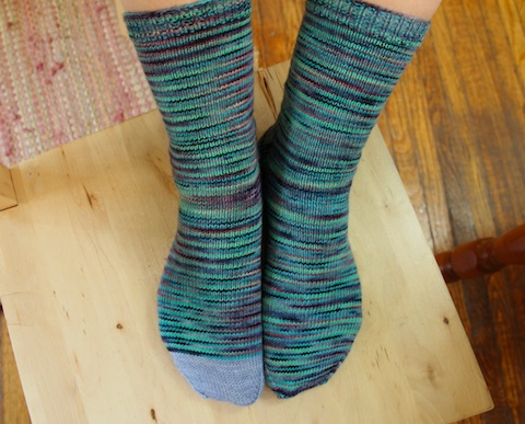 The two skeins knit up really differently. The first sock barely pooled at all (except around the gusset, which is to be expected), but the second sock flashed like crazy. This is why hand painted yarns are fun.