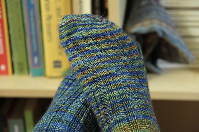 I knit both of these socks from the same skein, but they looks totally different. Somehow, the second half of the skein had way, way more of that rusty orange colour. I love that about hand painted yarns, especially with a pattern like this one.