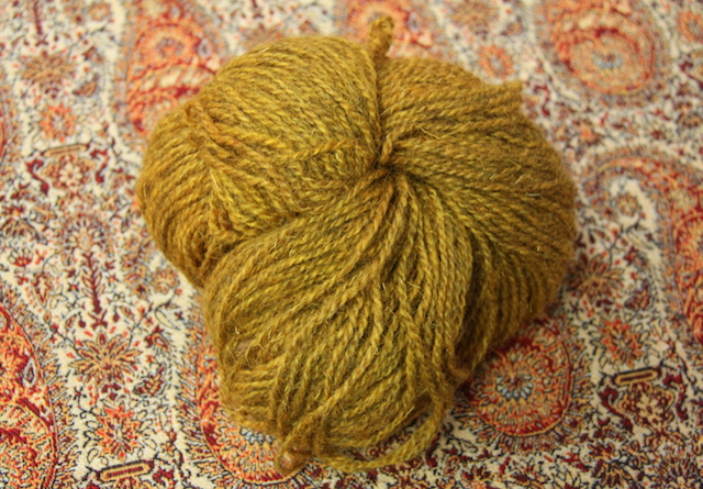 Last but not least, this skein of yarn, also from my parents. It was produced, from sheep to skein (or so I understand it), including the dyeing very near where I grew up. I don't know what kind of sheep it came from or its yardage (though it weighs 105g and is fingering weight-ish, so I'm guessing 300-350 yards) but it's soft and rustic and I'm thinking it will become a shawl. Maybe this one. What do you think?