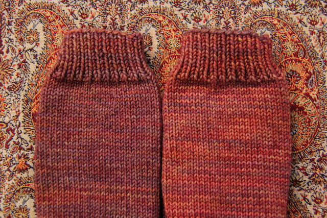 Weirdly, both cuffs/legs of the socks were knit from the same skein, despite looking totally different. The feet (top photo) are different dyelots, though.