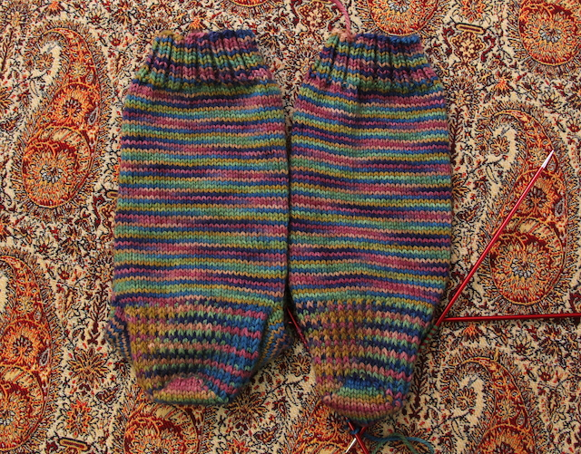 I turned the heel during the men's gold-medal game this morning, but since I have to work today, finishing these will have to wait.