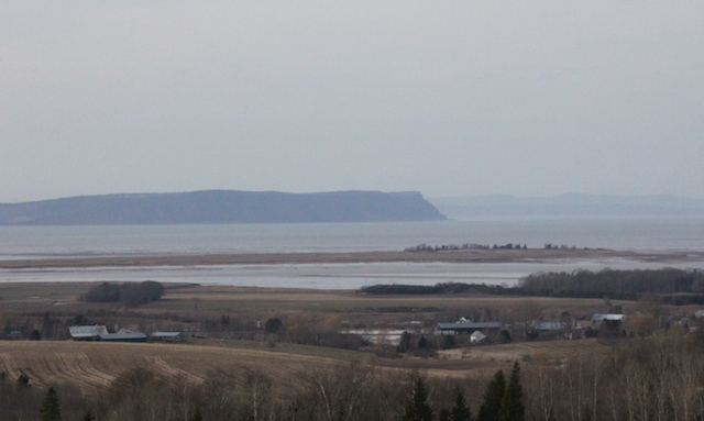 This is the classic view as you drive into the Annapolis Valley. The tide is in and that long dark peninsula is Blomidon, a provincial park and legendary home to the Mi'kmaq god Glooscap.
