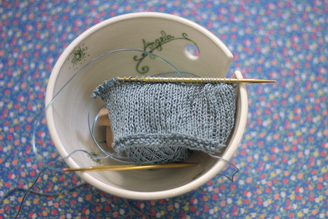 Swatching for Balta. (And yes, that is a personalized yarn bowl. My LYS is the best!)