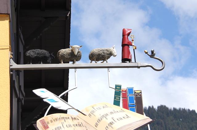 Funny, sheepy sign above a little restaurant in Villars, Swizerland.
