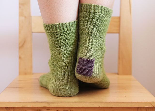 I used the knitted-on patch technique for this pair and it is holding up admirably.