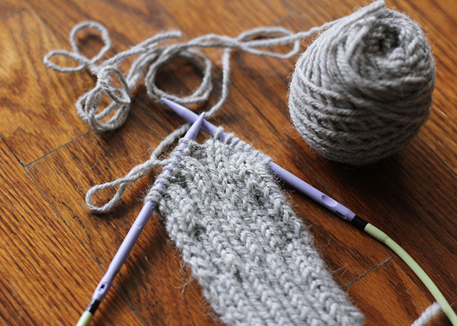 Purple needles and a green cord made this grey swatch a little more fun to look at.